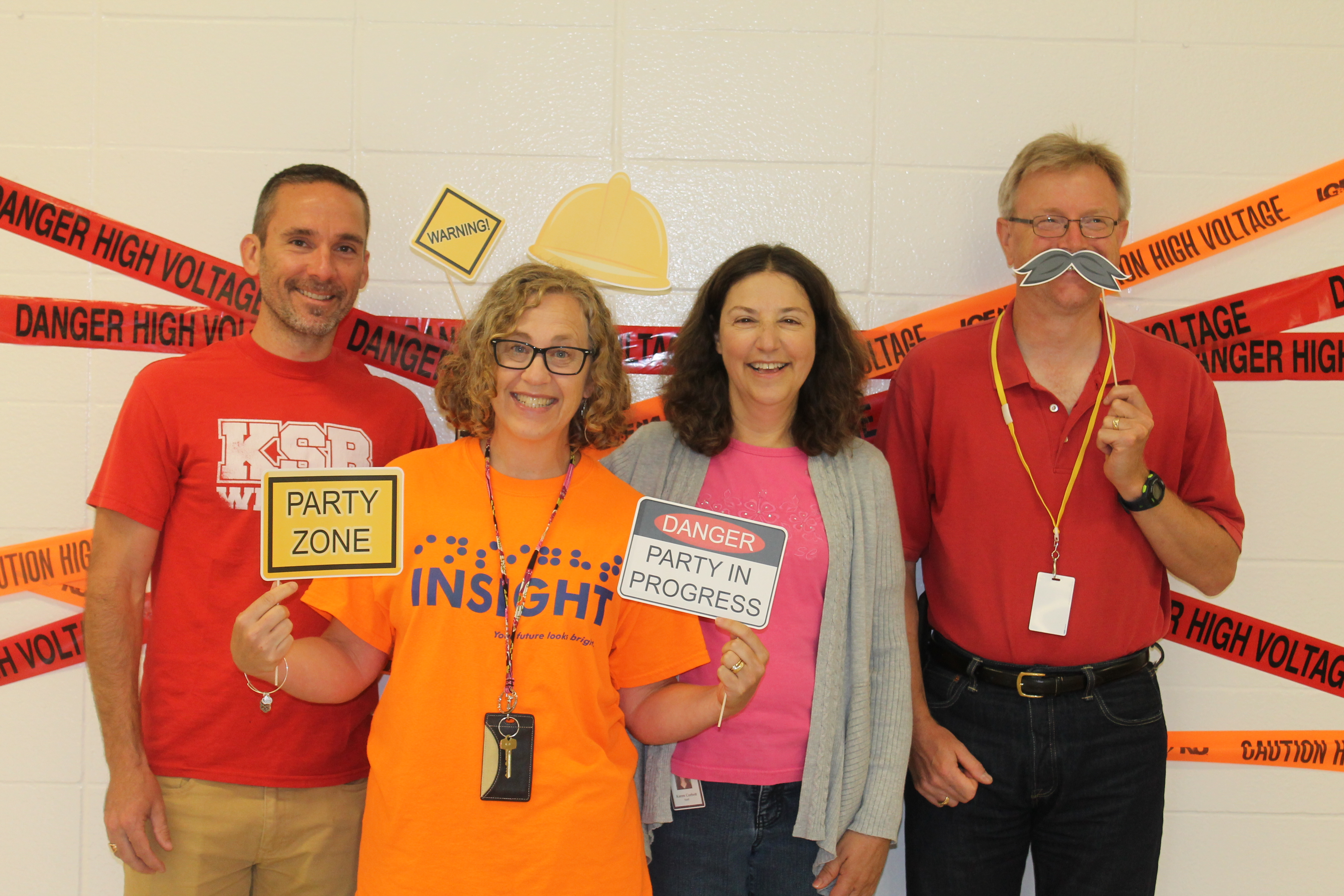 Short Term Teachers Pose in Photo Booth on Opening Day 2017